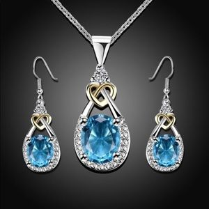 Blue Topaz WG Ring, Necklace and Earring set.